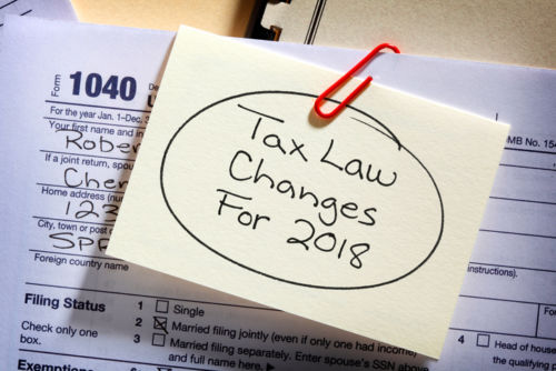 Tax Law Changes 2018 Sticky Note on Tax Form - KM Family Law