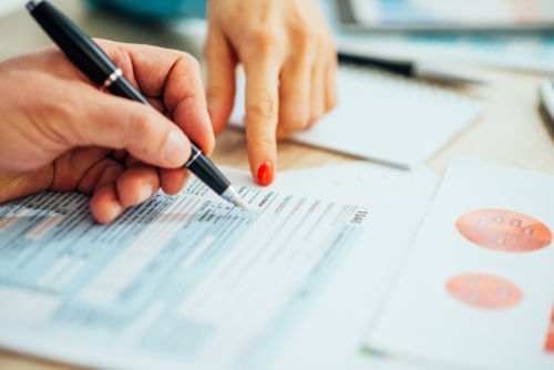 Filling Out Tax Form - KM Family Law