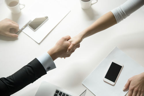 Couple Shaking Hands Making Debt Division Agreement - KM Family Law