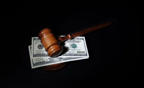 Gavel and Money representing Cost of Divorce - KM Family Law