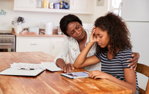 Mother Comforting Teen Daughter Who is Stressed Due to Parents' Divorce - KM Family Law