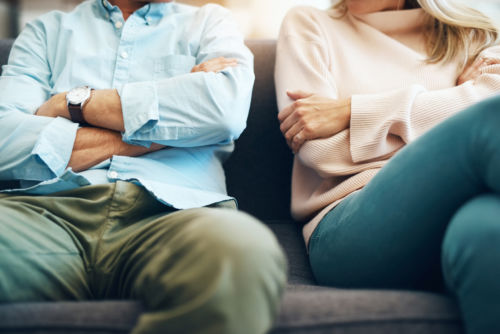 Couple on Couch Discussing Uncontested Divorce - KM Family Law